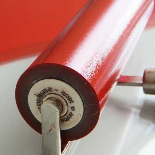 Red inky brayer for printmaking - Debbie Kendall