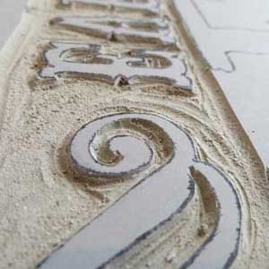 Letters carved into lino by Debbie Kendall