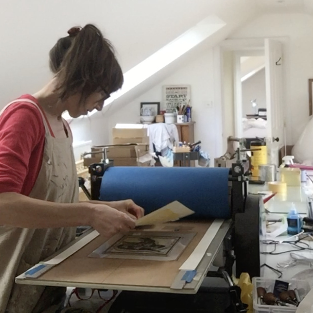 Printmaker using etching press | The Enlightened Hound